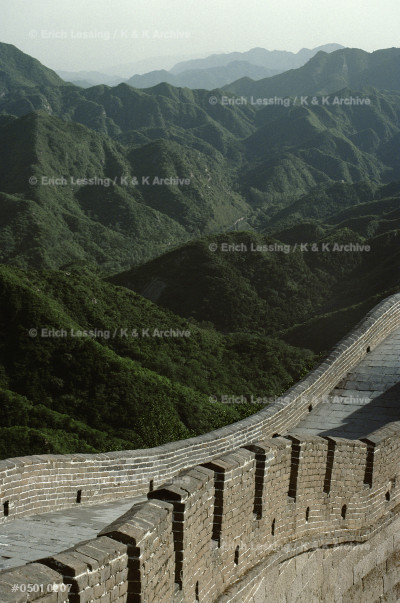 The Great Wall of China was begun by the first Emperor of the united country, Qin Shihuangdi, around 210 BCE. Its diconnected parts are about 5.000 kms long. The    wall is 7 to 8 m high and its paved top is 5,5 m wide. There is a watchtower every 120 m. See 05-01-02/1-12