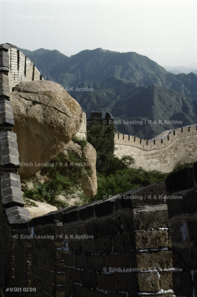 Great boulders are included in parts of the Great Wall of China, built by the first Emperor, Qin Shihuangdi,  around 210 BCE. The disconnected parts of the wall     are about 5.000 kms long, the wall is 7 to 8 m high    and the paved top is 5,5m wide. See 05-01-02/1-12.