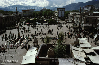 The main square in Lhasa, Tibet, with market booths,   