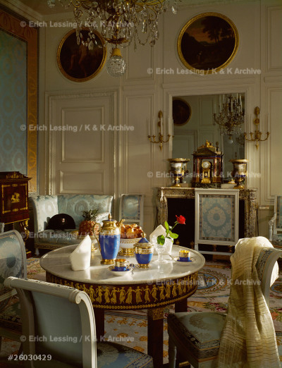 """The breakfast room of Emperor Napoleon I Bonaparte and  Empress Marie-Louise in the Trianon in Versailles. The table is laid with the Empire style Tea-set """"Vieux-Paris"""",property of the Emperor. One of his hats on the couch in the background."""