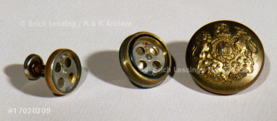 Compass hidden in uniform buttons of RAF pilots        (for closed position see 27-02-01/8), to help them     find their bearings in case they were shot down        over enemy territory.                                  World War II