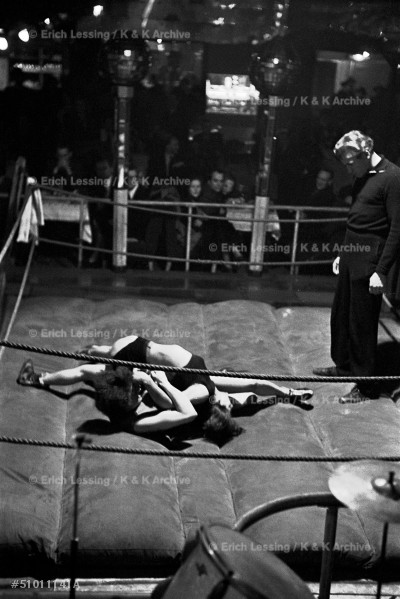 "Women wrestling in the ""Jungmuehle"", a waterfront-      