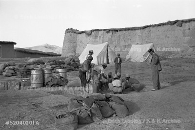 In 1952 locust swarms flying in from Saudi Arabia threatened Iran's harvest. In a unique cooperation, US and Soviet pilots and specialists sprayed the infested areas. Iranian soldiers mixing BHC bait for Soviet planes at Mehmetabad near Kerman.