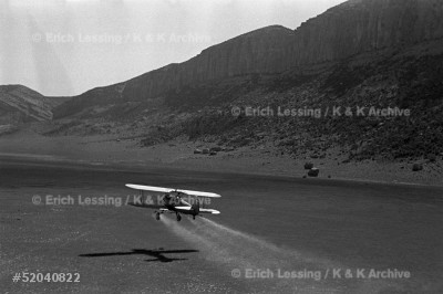 In 1952 locust swarms flying in from Saudi Arabia threatened Iran's harvest. In a unique cooperation, US and Soviet pilots and specialists sprayed the infested areas. The Stearman, a biplane, flying low over an infested area.