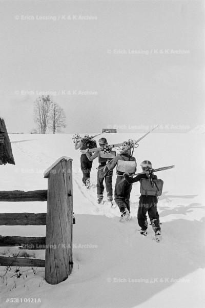 Children in the Austrian Enns valley ski to school.