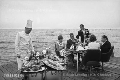 "The restaurant ""Kystensperle"" near Helsingør, Hamlet's castle, is famous for its rich seafood buffet, served on the seashore.  Denmark, 1961"