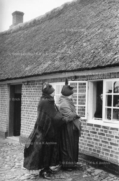 Women in local costume in Hans Christian Andersen's house in Odense, Denmark.