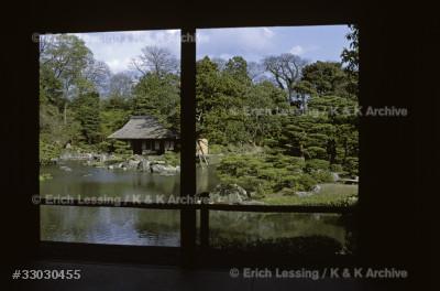 Kobori Enshu designed and built villa and gardens for prince Toshito in 1590. The gardens of Villa Katsura. A small tea-house in the gardens, seen from the villa.