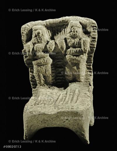 Couple on a votive bed. Fertility rite.                Hierogamus, from Susa, Persia.                         Terracotta (mid 2nd millennium)                        7.1 x 4.9 cm                                           Sb 6562