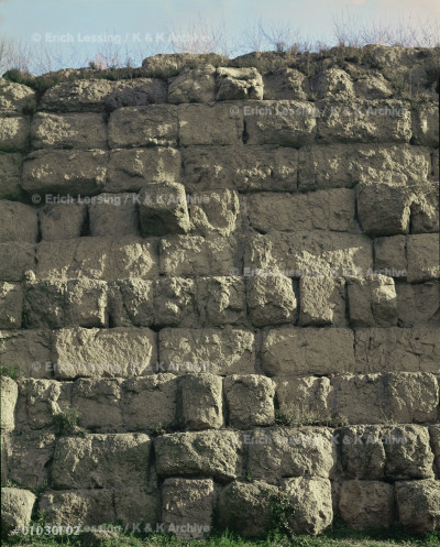 Servian fortification wall near the railway            station in Rome, Italy, erroneously named after        the Etruscan king Servius Tullius (578-534 BCE),       built around 390 BCE after the invasion of the Gauls.