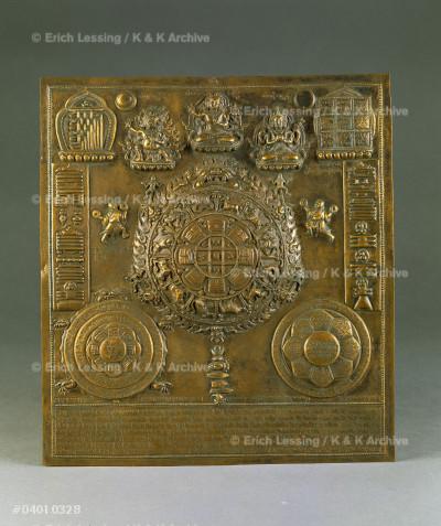 Astrological diagramm, brass; tantric wheel,           Buddha and guardians; Buddhist symbols.