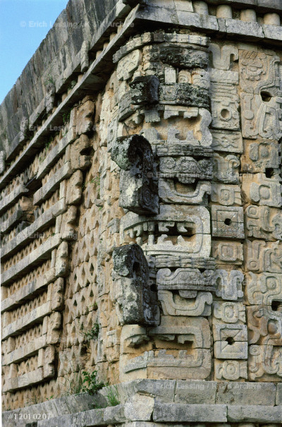 Masks of the rain-god Chac with his trunk-like         