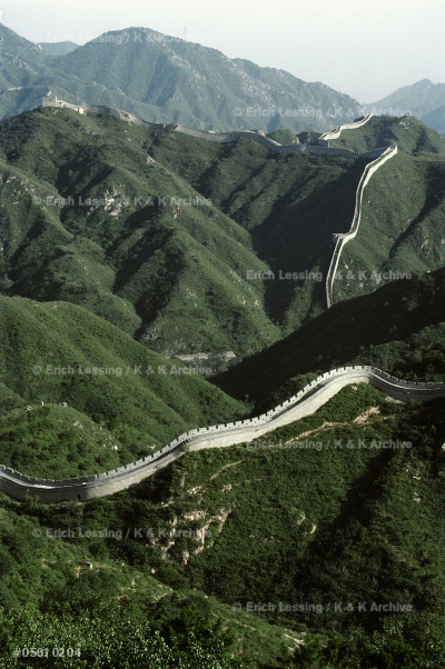 The Great Wall of China was begun by the first Emperor of the united country, Qin Shihuangdi, around 210 BCE. Its disconnected parts are about 5.000 kms long. The   wall is 7 to 8 m high and its paved top is 5,5 m wide. There is a watchtower every 120 m. See 05-01-02/1-12