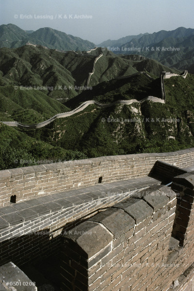 The great Wall of China was begun by the first Emperor of the united country, Qin Shihuangdi, around 210 BCE. Its diconnected parts are about 5.000 kms long. The    wall is 7 to 8 m high and its paved top 5,5 m wide.    There is a watchtower every 120 m. See 05-01-02/1-12