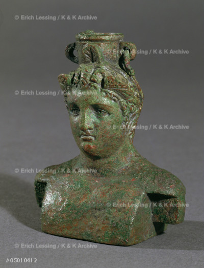 Weight, bronze or lead, woman's head.                  H: 7,9 cm  Graeco-Roman                                From the Treasure of Begram, Afghanistan, Room 13      MG 21230