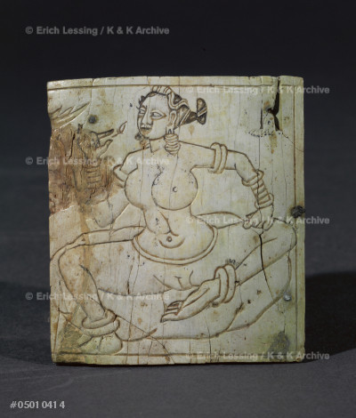 Woman sitting on a cushion.                            Engraved bone, H: 67 cm                                From the Treasure of Begram Afghanistan, 1st-2nd CE    MG 21340