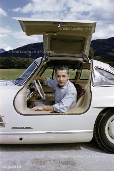 Conductor Herbert von Karajan and his Mercedes 300 SL.
