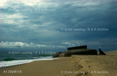 """Remains of the much-vaunted German """"Westwall"""" which    could not stop the Allies' invasion and liberation     of France. Today the concrete fortifications disappear in the dunes of fashionable beaches.                   Dunes near Cap Ferret."""
