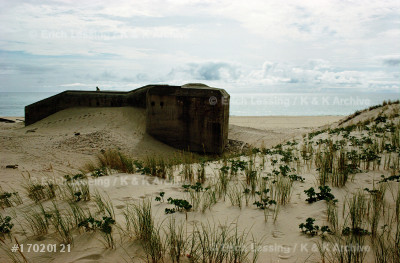 """Remains of the much-vaunted German """"Westwall"""" whichcould not stop the Allies' invasion and liberationof France. Today the concrete fortifications disappearin the dunes of fashionable beaches.Dunes near Cap Ferret."""