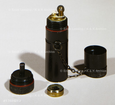 Lighter with hidden compass (see 27-02-01/10),         to help RAF pilots, Allied agents and members of       resistance groups find their way in enemy territory.   World War II