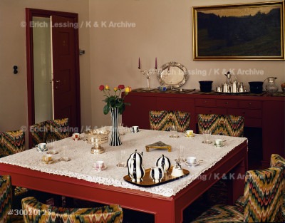 House of Mrs. Sonja Knips, Nusswaldgasse, 1922         Dining-room with coffee set and china by               Wiener Werkstaetten