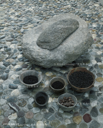 Grinding stone and corn