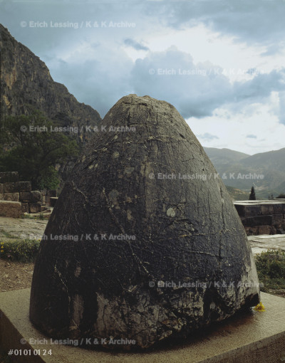 """The Omphalos, """"Navel of the World"""", Delphi, which,     according to Greek myths, stands in the centre of the  earth.                                                 Ornamented limestone"""
