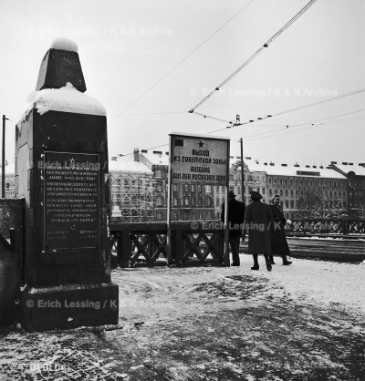 "Salztor-Bridge across the Danube Canal,Vienna.The signboard says:""Exit from the Russian Zone""; the monument at left reminds passers-by that ""this bridge was destroyed by German Fascists in 1945 and rebuilt upon orders of  Soviet Marshal Koniew.."" Vienna,1947"