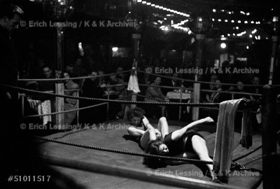 """Women wrestling in the """"Jungmuehle"""", a waterfront-       nightclub on the famous """"Reeperbahn"""" in Hamburg, 1951."""