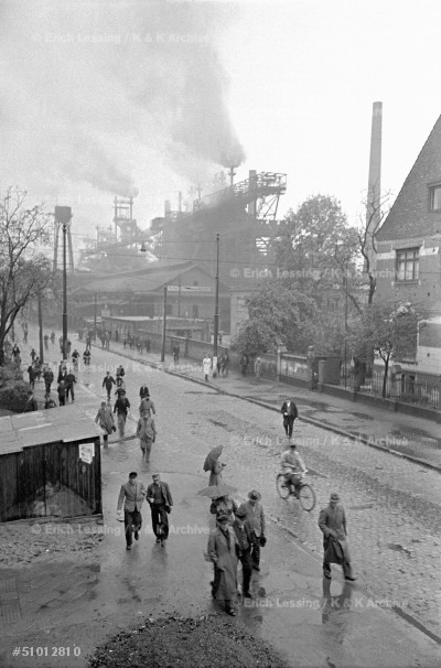 Change of shift: workers leaving the steelworks in Duisburg, West Germany, 1951.