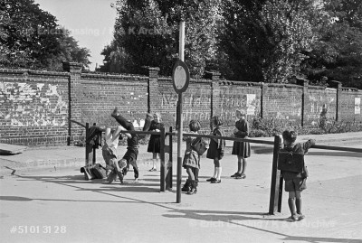 The border between East and West Berlin before the Berlin Wall was built in 1961. Children play on the fence which separates East and West.                    Berlin, 1951