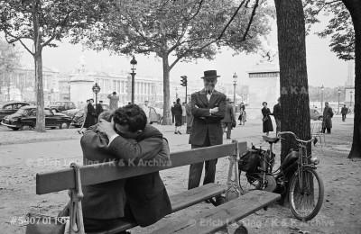 """Chansonnier Maurice Chevalier interprets his song """"Deux amoureux s'embrassaient sur un banc, l'un contre l'autre, enlaces tendrement...""""                                                                      Paris, 1954"""