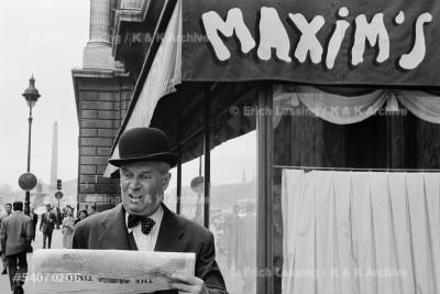 """Chansonnier Maurice Chevalier interprets his song:     """"Un gentleman, en hiver comme en ete,porte             toujours un chapeau Locke bien bombe, et par un        temps de pluie il n'ouvre jamais,jamais,son parapluie.""""Paris,1954"""