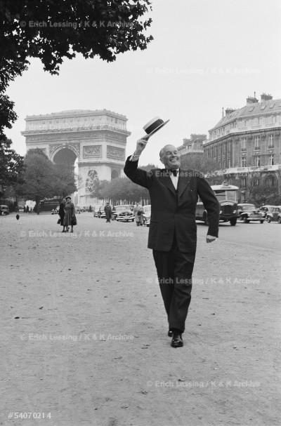 """Chansonnier Maurice Chevalier interprets his           song """"Quand je me promene sur l'Avenue Foch...""""        Paris, 1954"""