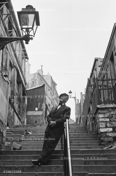 """Chansonnier Maurice Chevalier interprets his           song """"Les gars de Menilmontant sont toujours           remontant,meme en redescendant les rues de             Menilmuche..."""" Paris, 1954"""