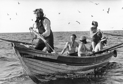 """John Huston's film """"Moby Dick""""after the novel by       Herman Melville, starred Gregory Peck,Orson Welles,    Friedrich Ledebur and Richard Basehart.Gregory Peck    (Captain Ahab)steers the boat across a stormy sea off  Gran Canaria.         Canary Islands,1954"""