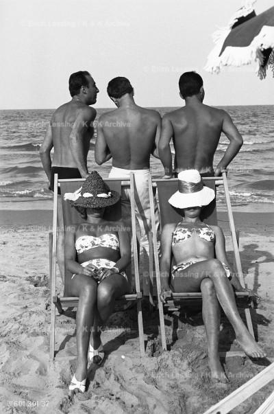 The happy life at an Italian beach. Cesenatico, Italy, 1960.