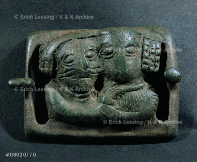 Belt buckle showing man and woman embracing.           Bronze (3rd BCE-1st CE)                                from south east Iran                                   Cat. 135 126