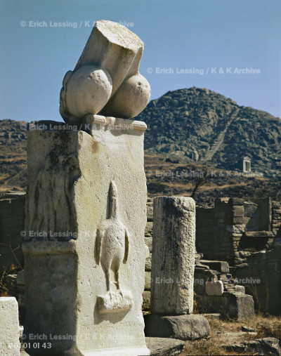 Dionysos sanctuary, Delos, monumental phallus with     a relief of the phallus-bird, a symbol of the God,     carried in procession or drawn on a chariot during     Dionysian rites. Inscription says monuments were       donated by Karystos, son of Asbelos. Around 300 BCE