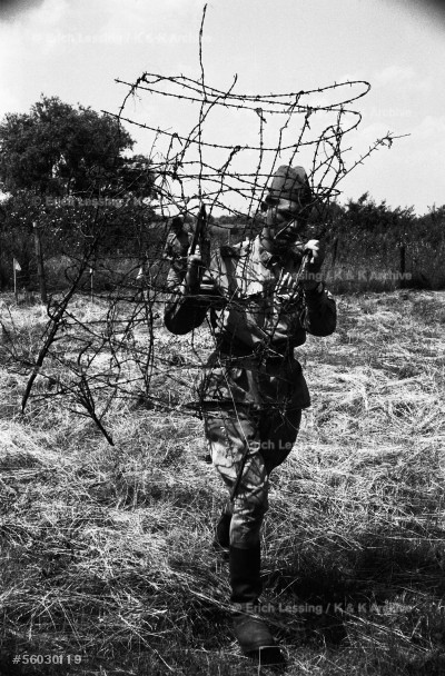 """The """"Iron Curtain"""" dividing Europe into East and West also divided Austria and Hungary. Between 10 May and early September 1956, in a brief thaw before the revolution, Hungarian soldiers cleared the area of mines and took down the barbed-wire fences on the Austrian border, 1956."""