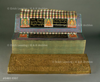 """Prajnaparamita-book that contains a well known         philosophical text of Mahayana, or """"Greater Vehicle""""   Buddhism. Buddhism came to Bhutan from India and       its texts were translated from Sanskrit into Tibetan.  Wood, sheet copper, silk cloth      24 x 69 cm"""
