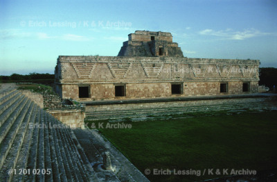 The Quadrangle of the Nuns, Uxmal. Four buildings,     each with a distinct design, surround a wide courtyard.The East Building, the Pyramid of the Soothsayer in    the background. The name of the buildings is a Spanish misinterpretation of their use (7th-10th CE).