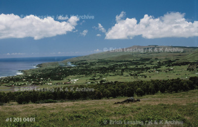Easter Island,called Rapa Nui by its Polynesian in-    habitants, is a volcanic island 3,790 kms west         of the Chilean coast. In the far background the villageof Hanga Roa, the only settlement on the island with   roughly 3.000 inhabitants.